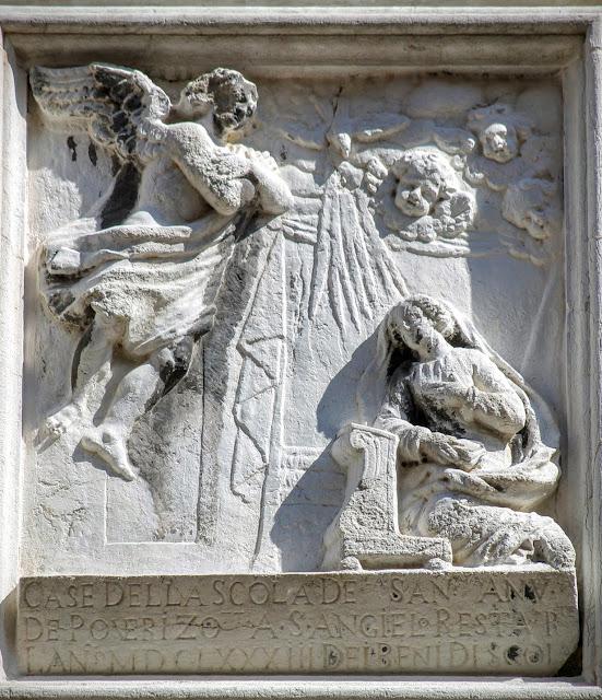 Stone relief of the Annunciation, Salizada San Samuele, Venice.