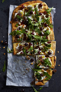 Pizza with arugula and ricotta cheese