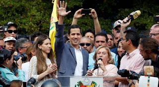 Venezuela opposition leader Guaido delivers first cargo of humanitarian aid