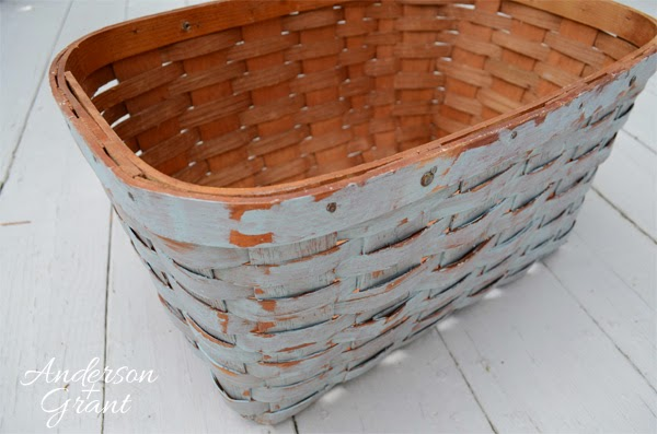 Add paint to the basket in a haphazard fashion to create a great, distressed finish.