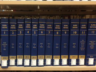 Alaska Statutes from 2014 on the Library shelf