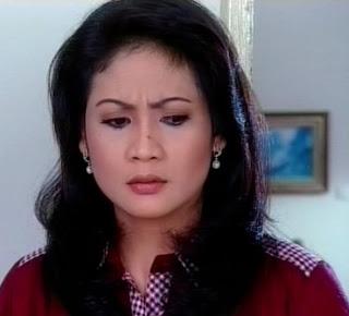 Hanna Hasyim sebagai Ibu Angkat Roni