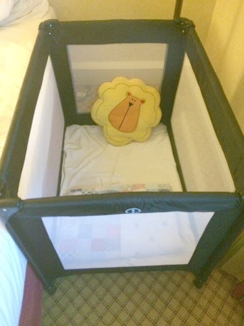 Travel cot at hotel