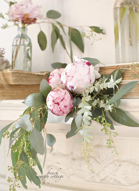 Vintage mantel with peonies and books