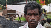 Indian coal miner (Picture Credit: Biswarup Ganguly [GFDL (http://www.gnu.org/copyleft/fdl.html) or CC BY 3.0 (http://creativecommons.org/licenses/by/3.0)], via Wikimedia Commons) Click to Enlarge.