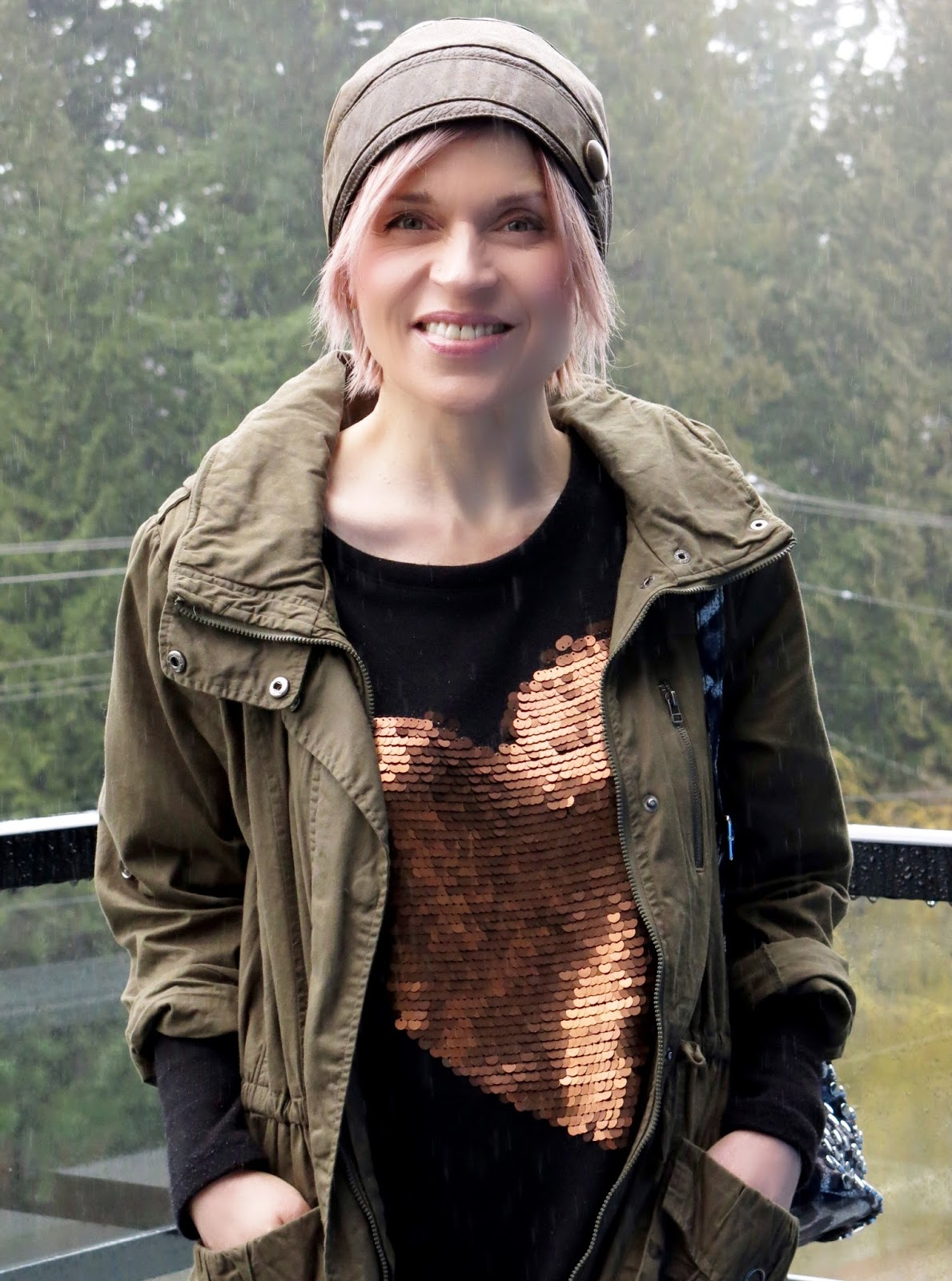 sequinned sweater, army parka, and leather beanie