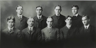 Group photo of the nine members of the Tuck School class of 1903
