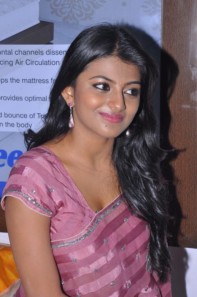 rosy loving Haasika hot n cute in purple saree hd images gallery