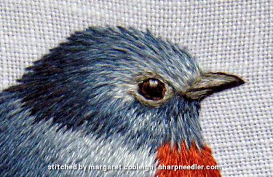 Trish Burr design: Embroidered head of blue bird in needlepainting