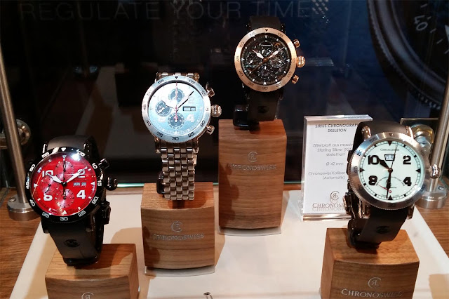 four chronoswiss watches, one with a red dial, one with a blue dial