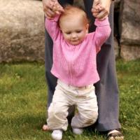 Baby Walking with Hands Held