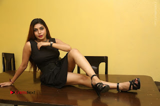 Tollywood Upcoming Actress Pooja Roshan Stills in Black Short Dress at Plus 1 Movie Trailer Launch  0377.JPG