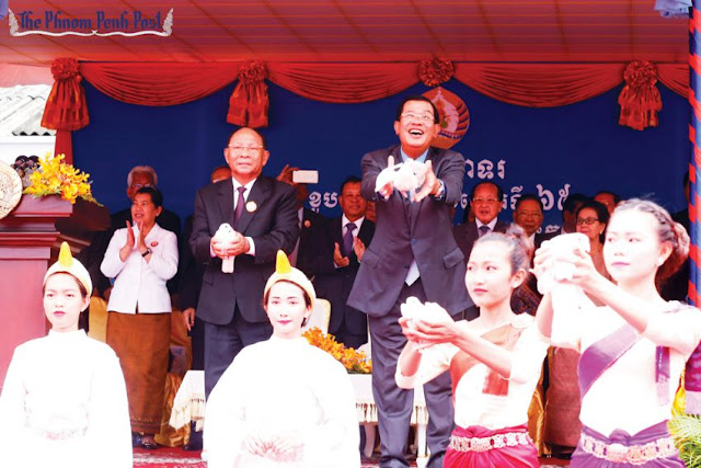 Prime Minister Hun Sen (right) and National Assembly President Heng Samrin release doves at a celebration of the ruling Cambodian People's Party's 65th anniversary yesterday. Heng Chivoan