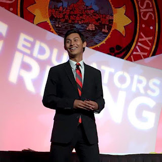 Audrain on stage speaking at Ed Rising conference