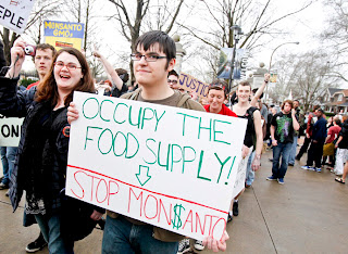 Occupy the Food Supply - Stop Monsanto - Members of Occupy movements in the Midwest protest against Monsanto's agricultural practises - Missouri Botanical Garden - US government lobbying for Monsanto across the globe
