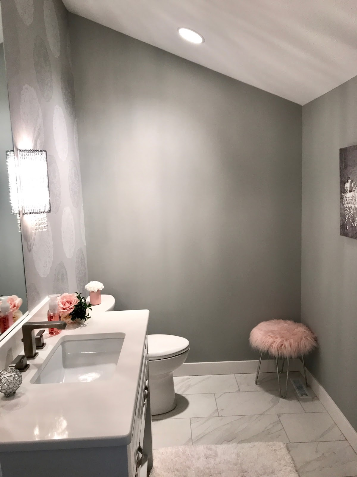 Just a little glam in this powder room. Gray and white with blush accents in this glamorous powder bath.