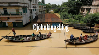 People paddled their boats as they try to move to safer places along a flooded street in West Midnapore district, in the eastern state of West Bengal.
