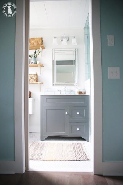 Penny tile floor in bathroom with gray vanity