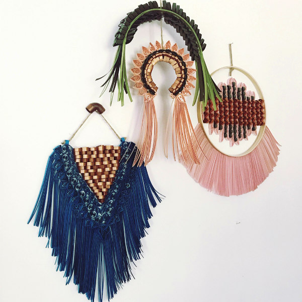 four blue, pink, peach, and green quilled macrame wall hangings