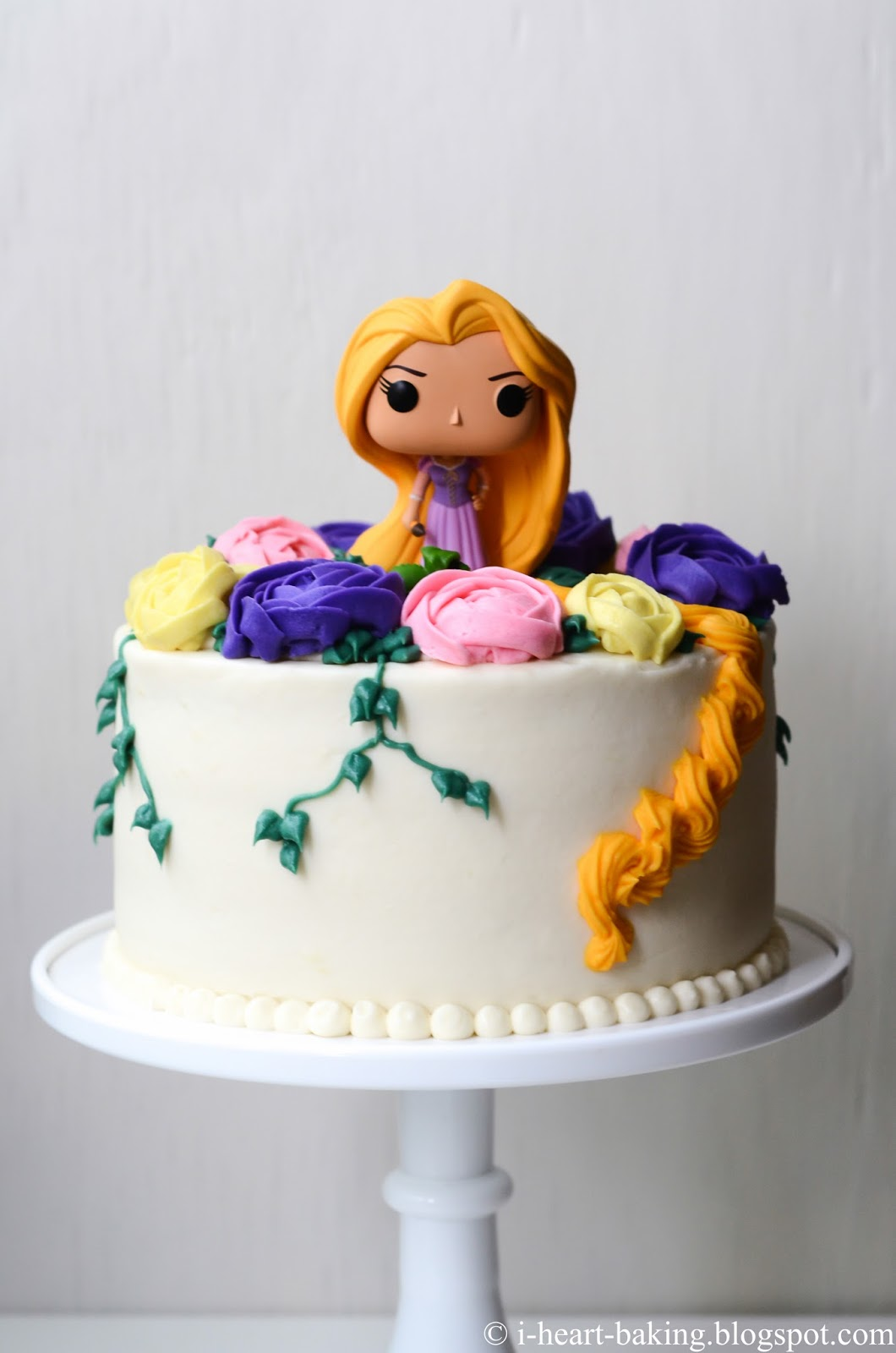 I heart baking tangled rapunzel birthday cake with buttercream flowers ive baked a lot of fun goodies for my friend monica over the past few years including pool party piggy cookies and a piggy cake a chevron gender reveal izmirmasajfo
