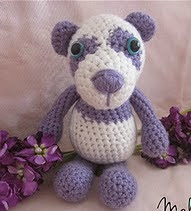 http://www.ravelry.com/patterns/library/precious-the-purple-panda