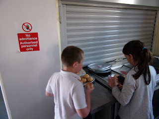 children preparing doughnuts for school disco