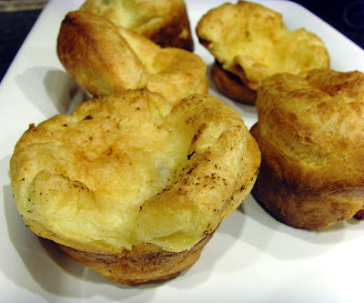 Individual servings of Yorkshire Pudding on a plate