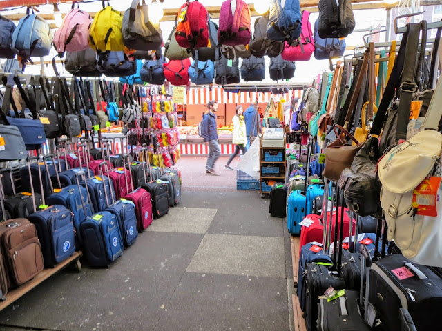 Top places to visit in the Netherlands: luggage stall at Albert Cuypmarkt in Amsterdam