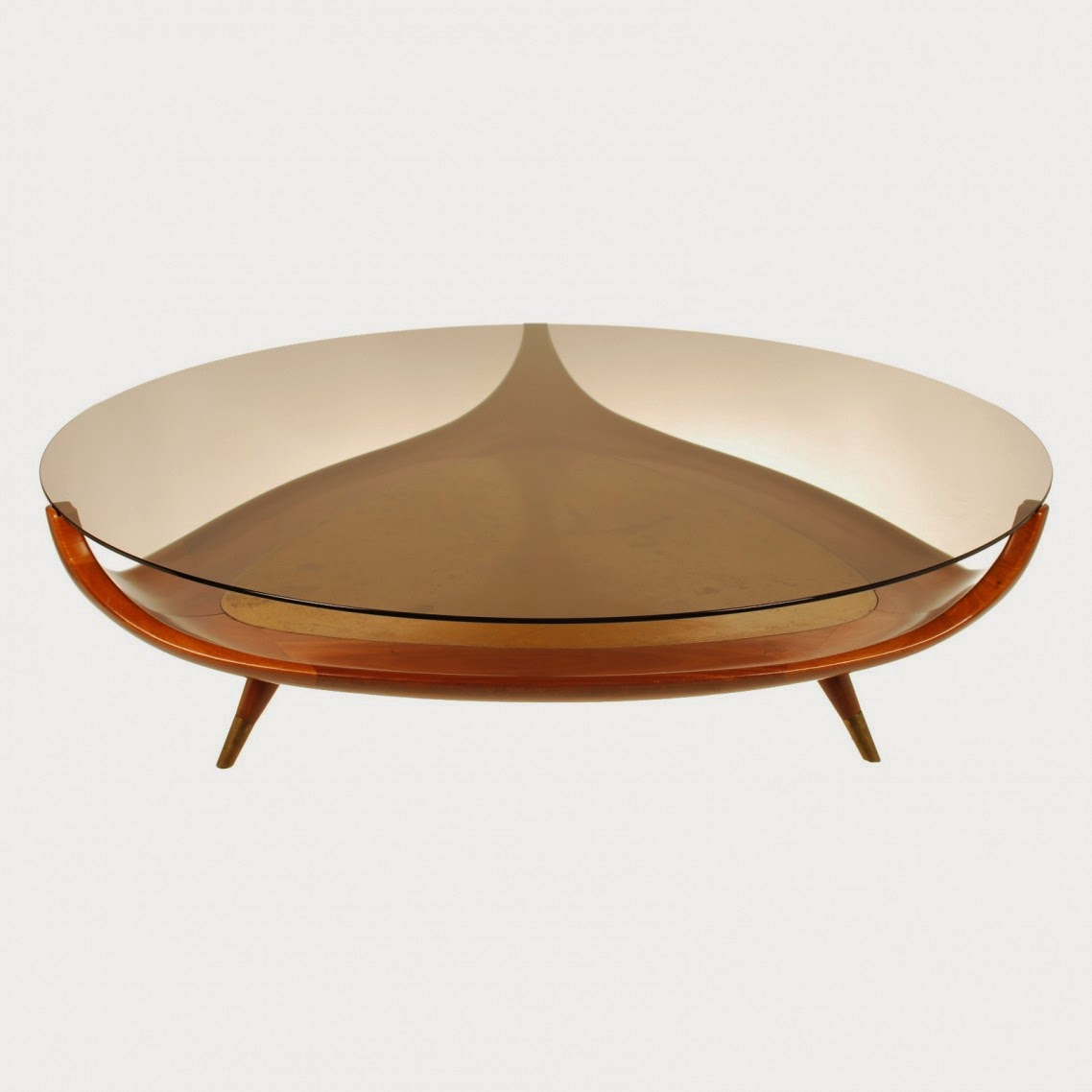 25 Elegant oval coffee table designs made of glass and wood
