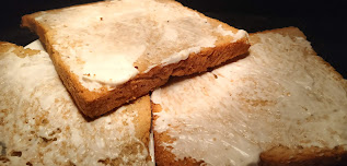 Mayonnaise spread on toasted brown bread  for veg club sandwich recipe