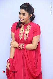 Actress Poorna Latest Stills in Red Dress at Rakshasi First Look Launch  0093.JPG