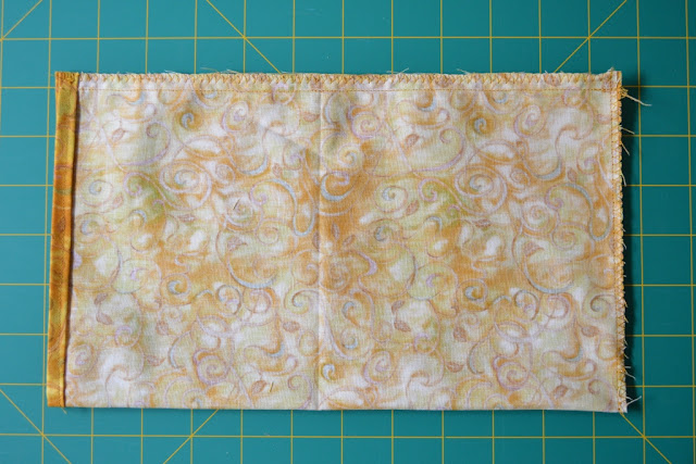 The finished lining, oriented sideways with the top hem at the left hand side and bottom seam on the right with side seam on the top.