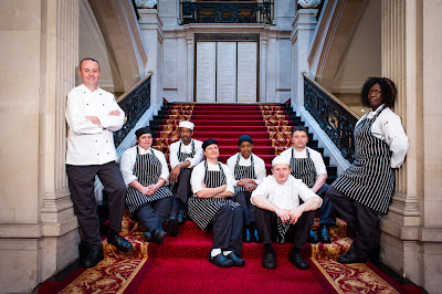 Chef and his wonderful team Photograph by Paul Dawson on our main staircase leading to the Great Hall