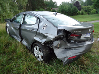 A photograph of our car, after the accident. Its left rear is smashed in. The car was totaled. My wife and I were OK, but could have suffered from whiplash.