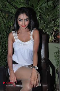 Actress Model Pooja Sri Stills in White Short Dress at F Club pre soft Launch  0240.JPG