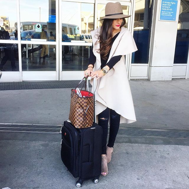 emily gemma, travel outfit idea, cute outfits for airport, sleeveless coat outfit, steve madden conley bootie, MM louis vuitton neverful damier, janessa leone hat