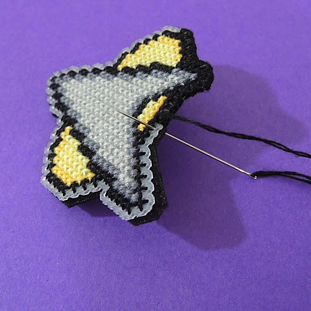 Overcast stitch felt to plastic canvas for a neat finish on star trek insignia badge