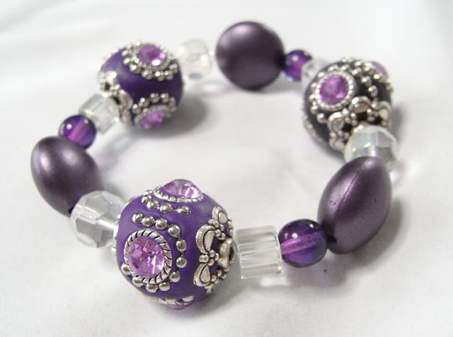 Stretch bracelet made with purple Kashmiri clay beads