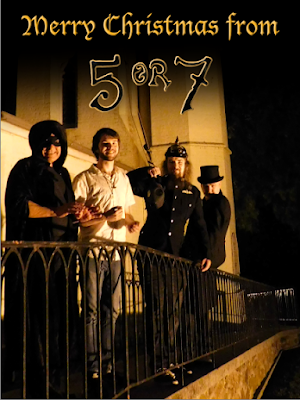 Russel, Jake, Jadyn and Gordon standing in front of a church with 'Merry Christmas from 5 or 7' above them