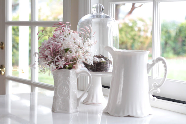 decorating-with-cloches-white-kitchen-cake-stand-flowers-spring