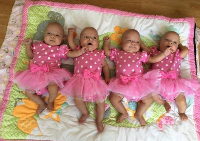 A woman gives birth to quadruplets