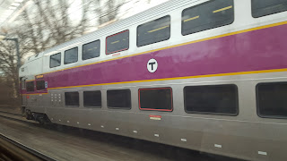 The Franklin Dean Train getting passed by another commuter rail line approaching Boston