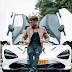 Kingsley Coman poses in front of his McLaren