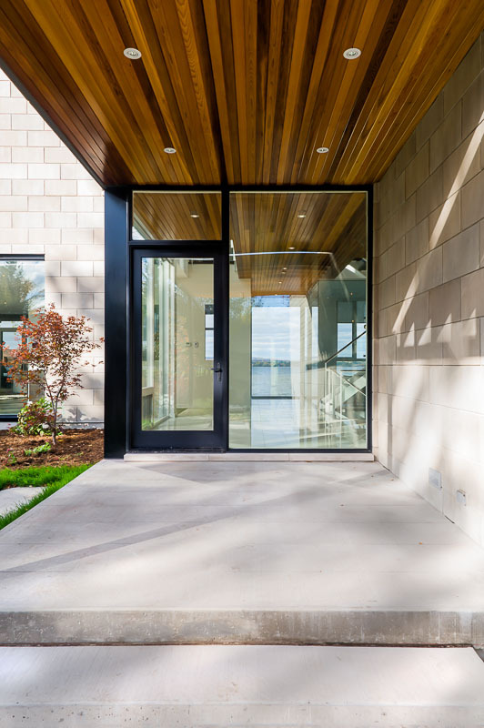 Entrance doors in Amazing Ottawa River House by Christopher Simmonds Architect