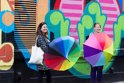 Colourful umbrellas and street art