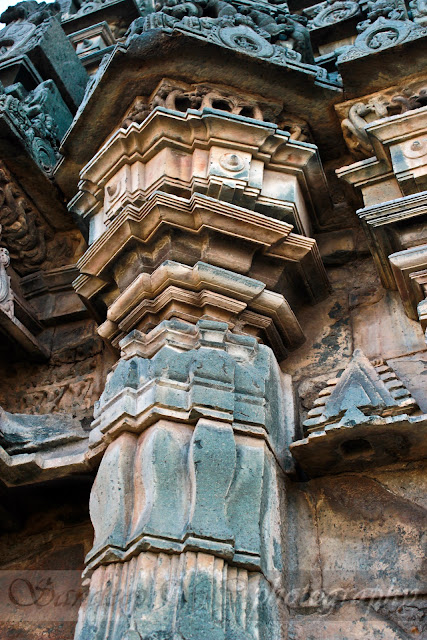 colorful columns on the exterior of the Suryanarayana Shrine, the colors are due to the natural exposure of the sandstone to rain and sun