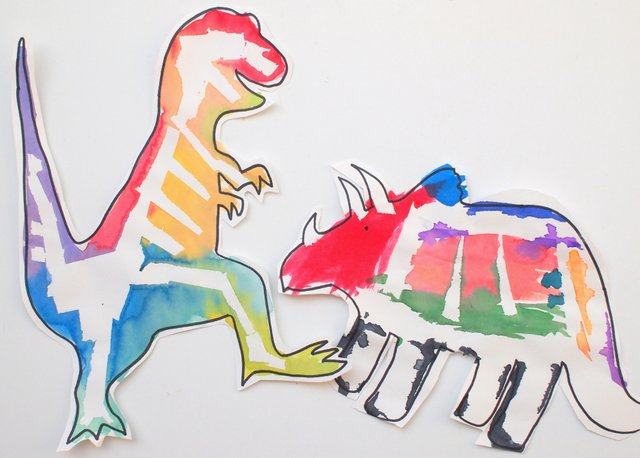 tape resist dinosaur bone paintings for preschool STEM and ART project