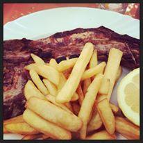 Cypriot food, taverna pork chop Mandria Paphos