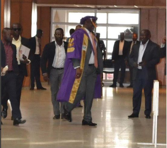 dino melaye enters senate clad in full academic regalia.