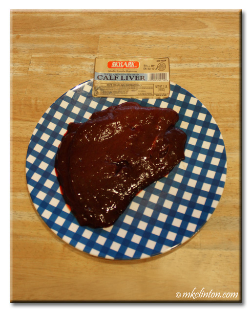 Calf liver on blue checkered plate